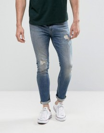Asos Super Skinny Jeans In Mid Blue With Rip And Repair afbeelding
