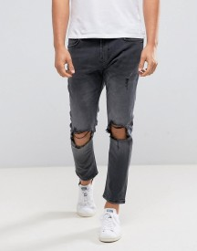 Bershka Skinny Tapered Jeans With Knee Rip In Washed Black afbeelding