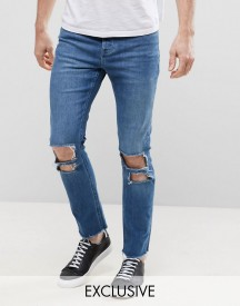 Mennace Relaxed Skinny Cropped Jeans With Rips And Raw Hem In Mid Wash afbeelding