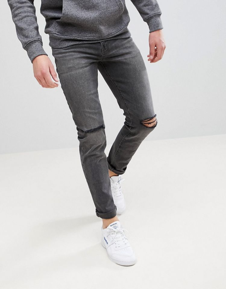 Image Asos Design Skinny Jeans In Vintage Washed Black With Knee Rips
