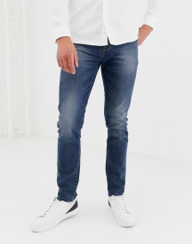 Asos Design 12.5oz Skinny Jeans In Smokey Blue With Raw Hem afbeelding