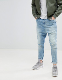 Asos Design Drop Crotch Jeans In Mid Wash Blue With Rips afbeelding