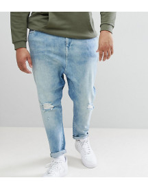 Asos Design Plus Drop Crotch Jeans In Mid Wash Blue With Rips afbeelding