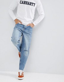 Asos Design Skater Jeans In Mid Wash Blue With Rips afbeelding