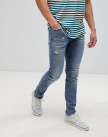 Asos Design Skinny Jeans In Dark Wash Blue With Abrasions afbeelding