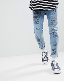 Asos Design Skinny Jeans In Mid Wash Blue With All Over Grunge Prints afbeelding