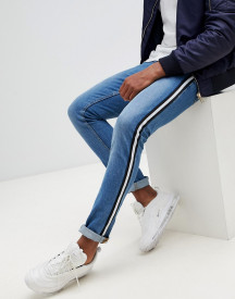 Asos Design Super Skinny Jeans In Mid Wash Blue With Side Stripe afbeelding
