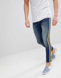 Asos Design Super Skinny Jeans In Mid Wash With Yellow Side Stripes afbeelding
