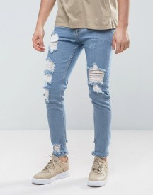 Asos Skinny Jeans In Light Wash Blue Vintage With Heavy Rips And Repair afbeelding