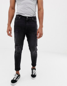 Bershka Carrot Fit Jeans In Black With Rips And Hem Taping afbeelding