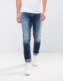 Calvin Klein Jeans Skinny Tapered Jeans With Rip And Repair afbeelding