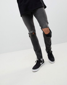Cheap Monday Tight Skinny Ripped Jeans With Error Message afbeelding