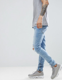 Criminal Damage Skinny Jeans In Lightwash Blue With Distressing afbeelding